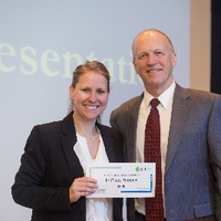 3MT First place winner Kathryn Ellens with the dean of The Graduate School